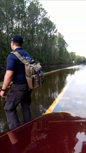 Inspecting Hurricane Flooded Roadway en-route to Client